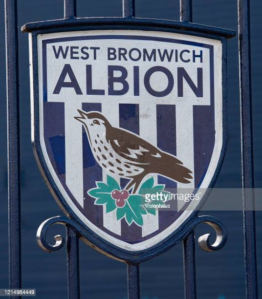 West Bromwich Albion club crest on the Jeff Astle gates at the Birmingham Road End of the Hawthorns home of West Bromwich Albion FC on March 23 2020...