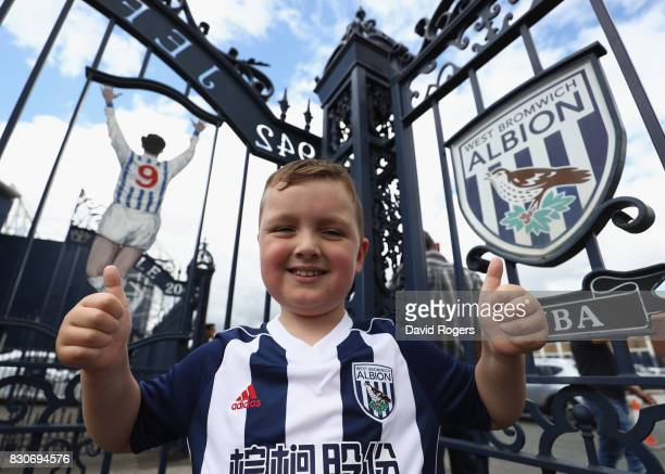West Bromwich Albion fan poses for a photo outside the Jeff Astle gate prior to the Premier League match between West Bromwich Albion and AFC...