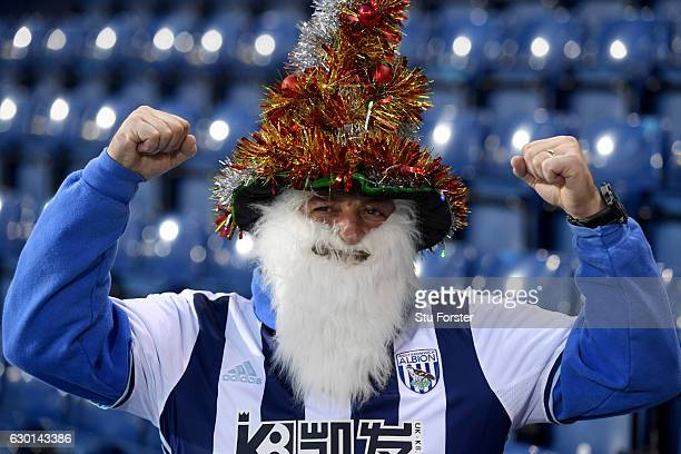 West Bromwich Albion fan poses for a photograph prior to kick off during the Premier League match between West Bromwich Albion and Manchester United...