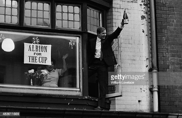 A West Bromwich Albion fan showering champagne onto supporters from a window following the teams win in the FA Cup May 19th 1968