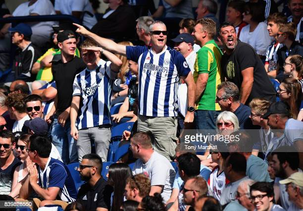 West Bromwich Albion fans celebrate during the Premier League match between West Bromwich Albion and Stoke City at The Hawthorns on August 27 2017 in...