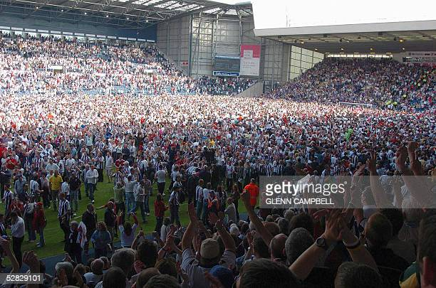 West Bromwich Albion fans celebrate on the pitch after beating Portsmouth 20 in their premiership match and escaping relegation in West Bromwich 15...