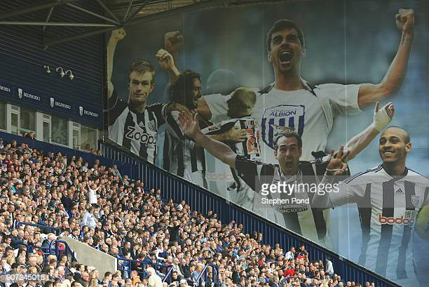 West Bromwich Albion fans celebrate their team socring during the Premier League match between West Bromwich Albion and West Ham United at The...