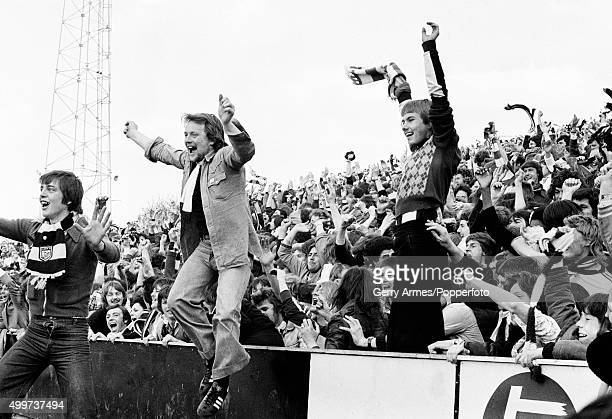 West Bromwich Albion fans celebrating as their team gain promotion to Division One in spite of a 10 defeat against Oldham Athletic at Boundary Park...