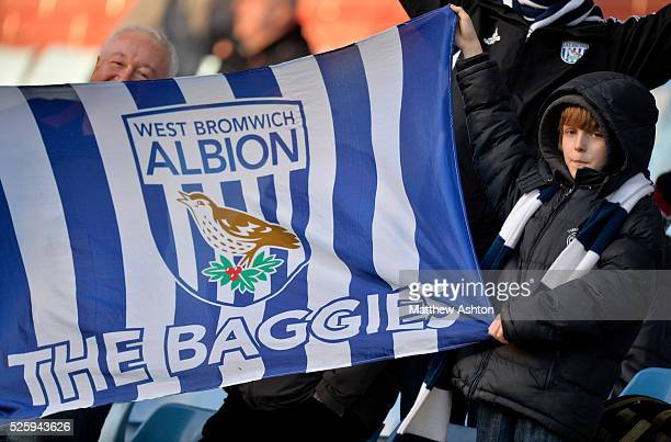 West Bromwich Albion Fans hold a flag