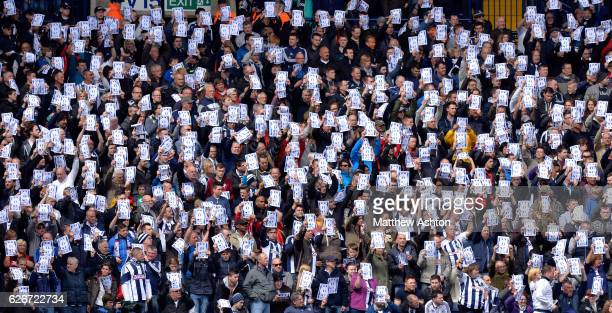 West Bromwich Albion Fans hold up Justice for Jeff Astle posters up on 9 mins played