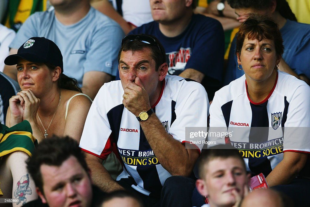 West Bromwich Albion fans look dejected as their side suffer defeat : News Photo