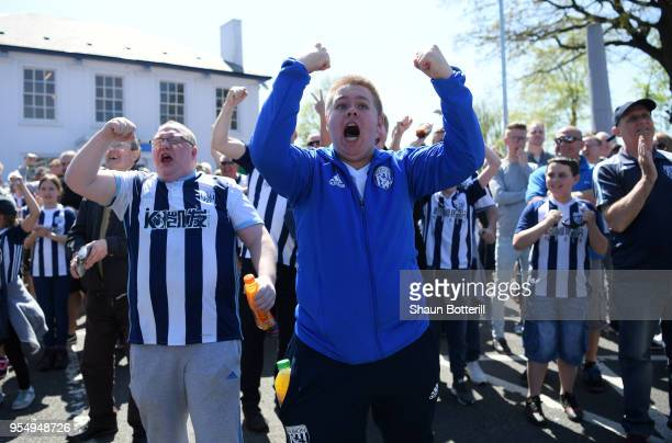 West Bromwich Albion fans react as they watch the Stoke City and Crystal Palace game prior to the Premier League match between West Bromwich Albion...