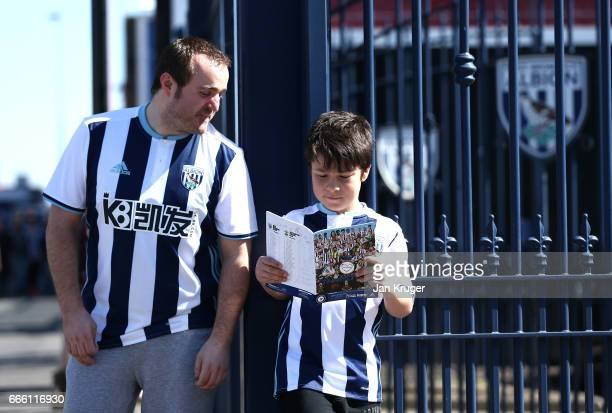 West Bromwich Albion fans read the match day programme prior to the Premier League match between West Bromwich Albion and Southampton at The...