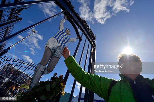 West Bromwich Albion Fans touch the Jeff Astle memorial gates on Jeff Astle Day celebrating the former WBA legend who made his debut against...