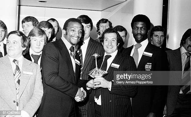 West Bromwich Albion footballer Cyrille Regis receiving the Midlands Sports Personality of the Year trophy from Welsh rugby union International...