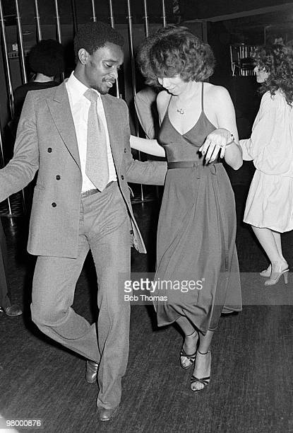 West Bromwich Albion footballer Laurie Cunningham dancing with American singer Helen Scott of the Three Degrees at the Holy City Zoo nightclub in...