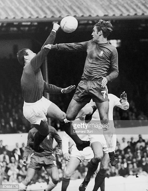 West Bromwich Albion goalkeeper Dick Sheppard punches the ball clear preventing a header by Tommy Baldwin of Chelsea during a First Division match at...