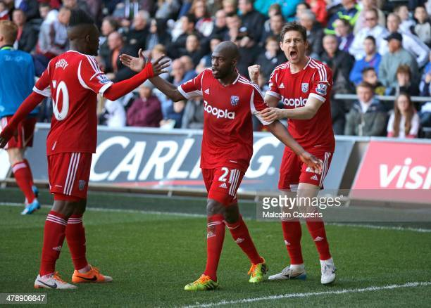 West Bromwich Albion goalscorer Youssouf Mulumbu celebrates his goal with Thievy Bifouma and Zoltan Gera during the Barclays Premier League match...