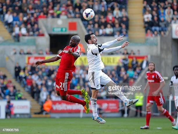 West Bromwich Albion goalscorer Youssouf Mulumbu competes with Leon Britton of Swansea Barclays Premier League match between Swansea City and West...