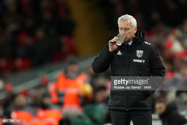 West Bromwich Albion Head Coach / Manager Alan Pardew has a drink during the Premier League match between Liverpool and West Bromwich Albion at...