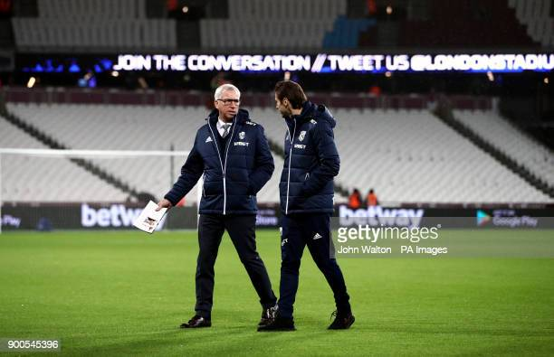 West Bromwich Albion manager Alan Pardew talks to Grzegorz Krychowiak on the pitch prior to the Premier League match at London Stadium