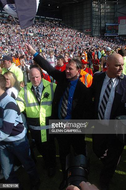 West Bromwich Albion manager Bryan Robson celebrates with the fans on the pitch after beating Portsmouth 20 in their premiership match and escaping...