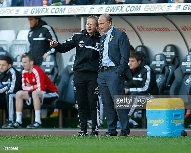 West Bromwich Albion manager Pepe Mel chats with his assistant Keith Downing during the Barclays Premier League match between Swansea City and West...