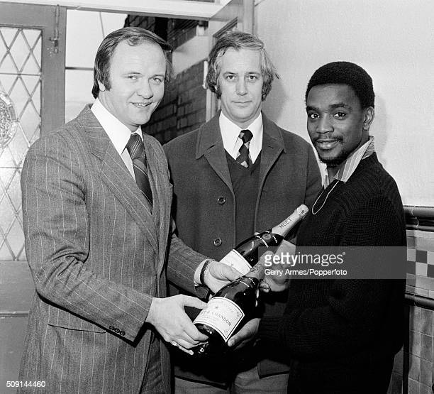 West Bromwich Albion manager Ron Atkinson presents Laurie Cunningham with some bottles of champagne as the winner of the monthly Sports Personality...