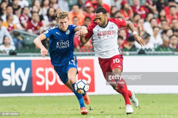 West Bromwich Albion midfielder Matt Phillips fights for the ball with Leicester City FC defender Callum Elder during the Premier League Asia Trophy...