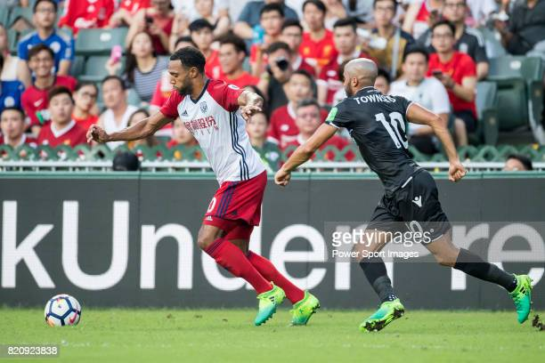 West Bromwich Albion midfielder Matt Phillips is followed by Crystal Palace midfielder Andros Townsend during the Premier League Asia Trophy match...