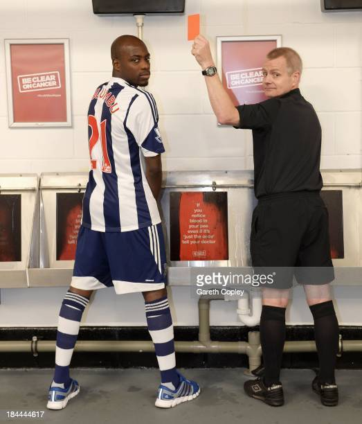 West Bromwich Albion midfielder Youssouf Mulumbu helps show bladder and kidney cancer the red card by supporting the new Be Clear on Cancer campaign...