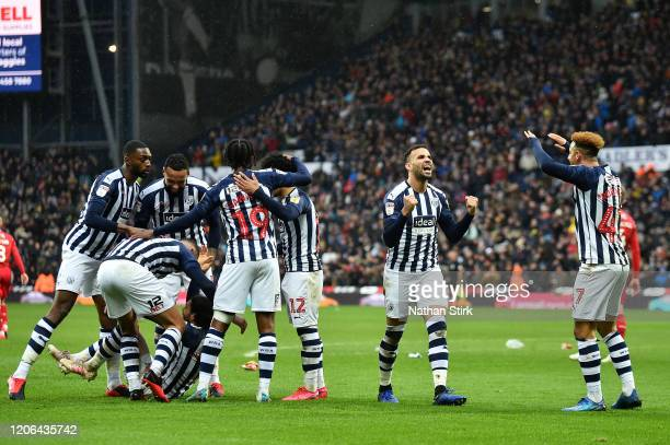 West Bromwich Albion players celebrate following their team's second goal, and own goal by Tobias Pereira Figueiredo of Nottingham Forest during the...