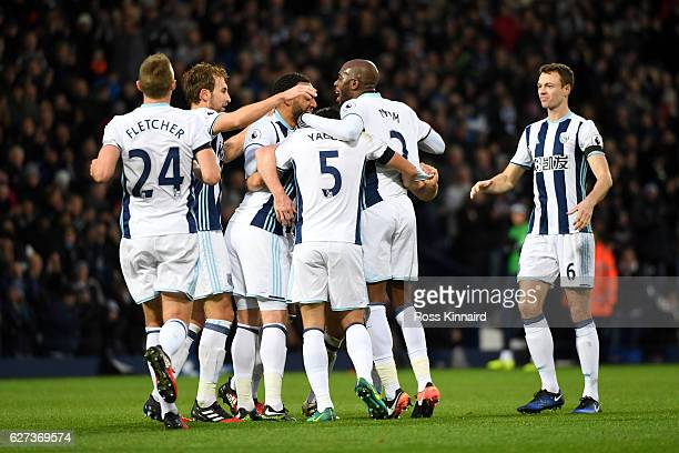 West Bromwich Albion players celebrate their team's second goal scored by Chris Brunt during the Premier League match between West Bromwich Albion...