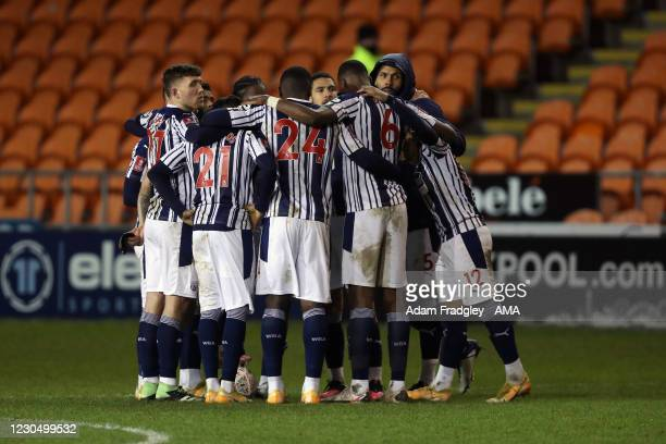 West Bromwich Albion players form a huddle after they exit the FA Cup in a penalty shoot-out during the FA Cup Third Round match between Blackpool...