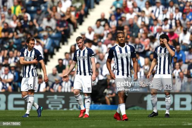 West Bromwich Albion players look dejected after conceeding during the Premier League match between West Bromwich Albion and Liverpool at The...