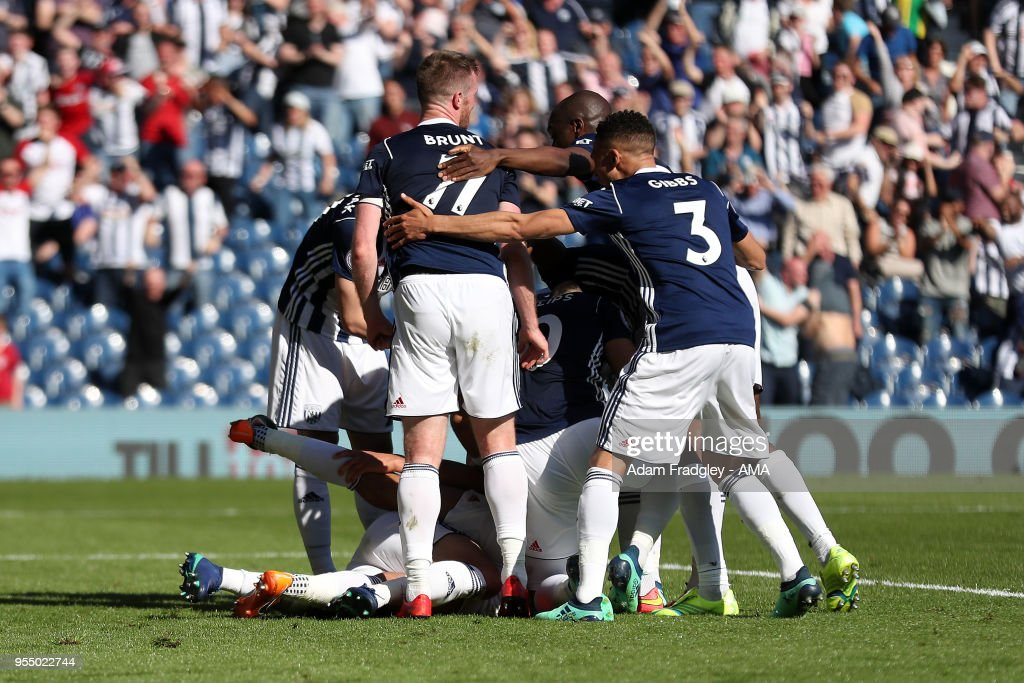 West Bromwich Albion players mob Jake Livermore of West Bromwich Albion after he scored a last minute goal to make it 1-0 during the Premier League match between West Bromwich Albion and Tottenham Hotspur at The Hawthorns on May 5, 2018 in West Bromwich, England.