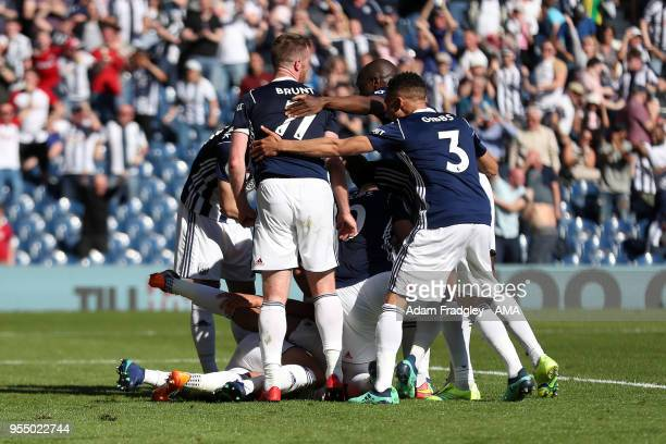 West Bromwich Albion players mob Jake Livermore of West Bromwich Albion after he scored a last minute goal to make it 10 during the Premier League...