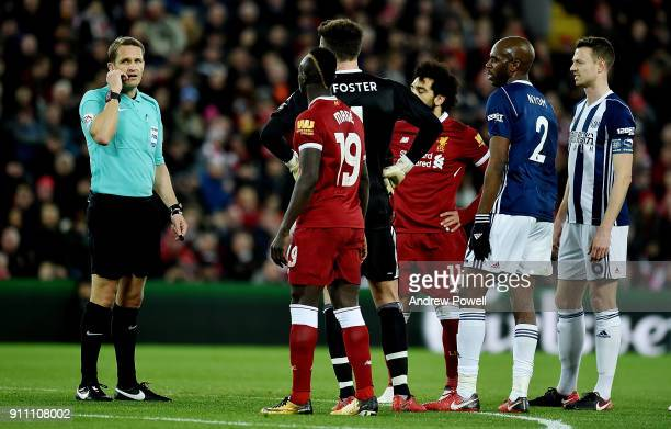 West Bromwich Albion players react around to Referee Craig Pawson after he consults the VAR system during The Emirates FA Cup Fourth Round match...