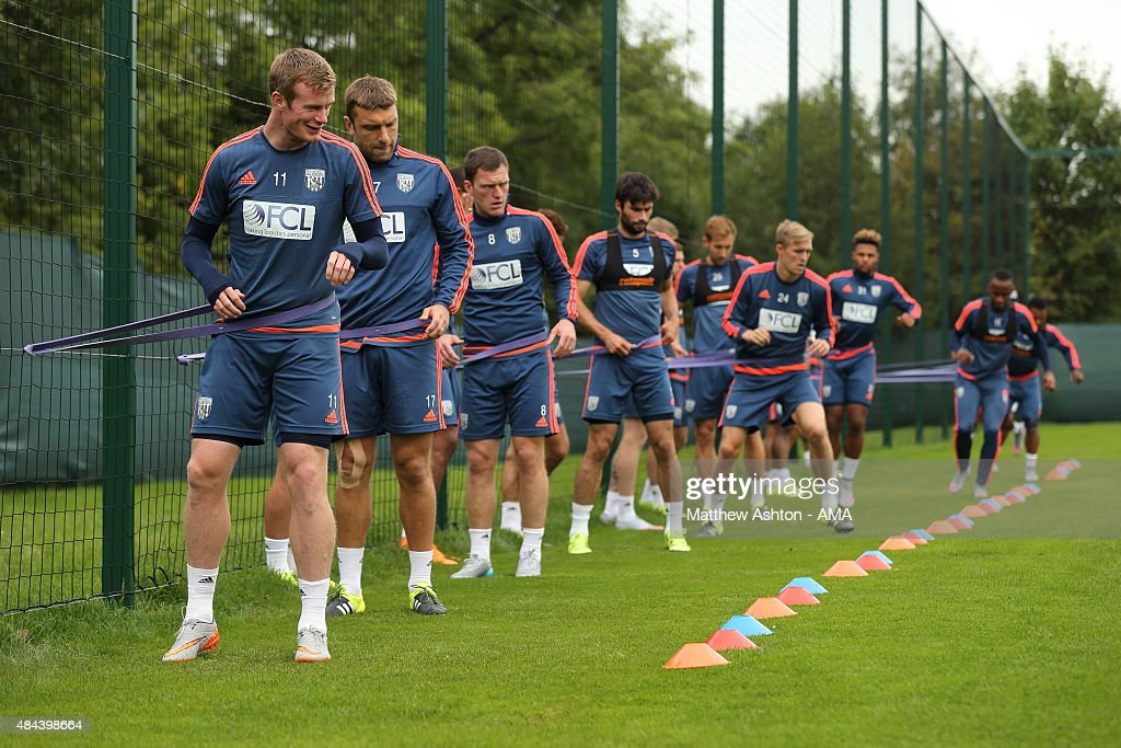 West Bromwich Albion players training doing exercises with elastic bands during the West Bromwich Albion training session at West Bromwich Albion Training Ground on August 18, 2015 in Walsall, England.