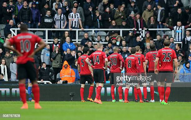 West Bromwich Albion players wait to see if a first half goal scored by Cheick Tiote of Newcastle United would be allowed during the Barclays Premier...