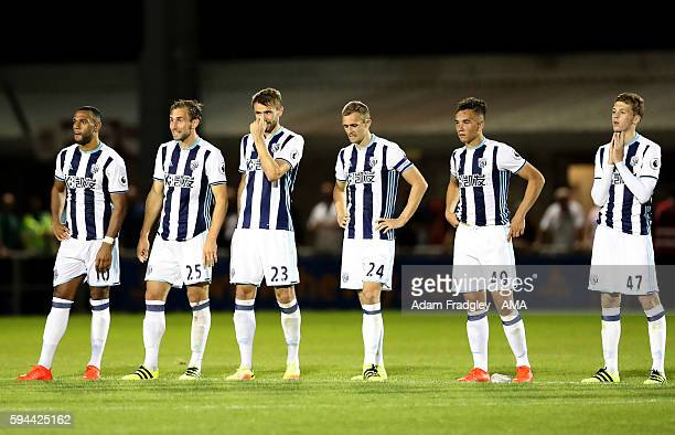West Bromwich Albion players watch as they lose 43 on penalties during the EFL Cup fixture between Northampton Town and West Bromwich Albion at...