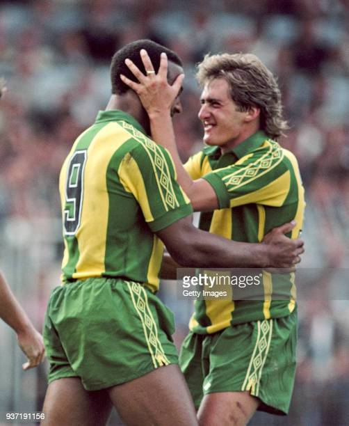 West Bromwich Albion striker Cyrille Regis and Gary Owen celebrate a goal during a First Divsion match against Brighton and Hove Albion at the...