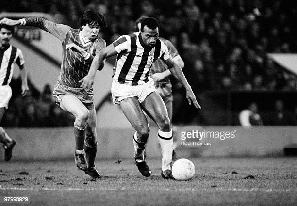 West Bromwich Albion striker Cyrille Regis is challenged by Liverpool defender Alan Hansen during their Division One league match held at The...