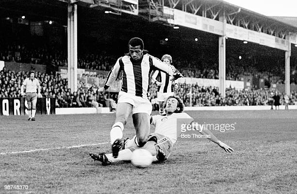 West Bromwich Albion striker Cyrille Regis is tackled by Newcastle United defender Alan Kennedy during their First Division match at the Hawthorns in...