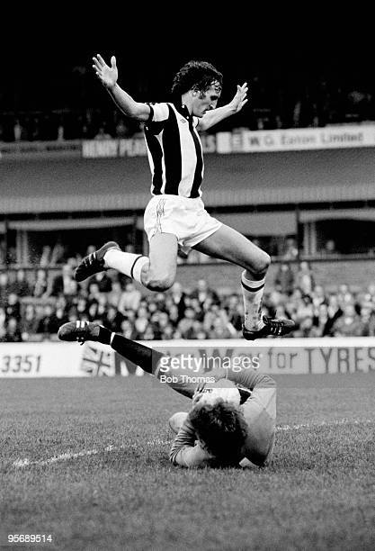 West Bromwich Albion striker David Cross jumps over Manchester United goalkeeper Alex Stepney during their First Division league match at the...