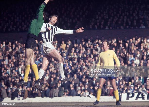West Bromwich Albion striker Jeff Astle challenging the Chelsea goalkeeper Peter Bonetti with John Dempsey looking on during their First Division...