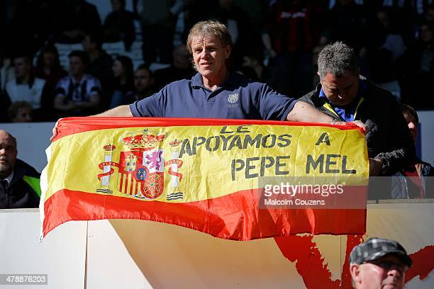 West Bromwich Albion supporters display Spanish flags in support of their manager Pepe Mel during the Barclays Premier League match between Swansea...