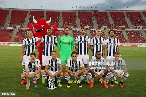 West Bromwich Albion team group with the RDC Mallorca mascot, Dimonio during the Pre-Season Friendly between RCD Mallorca and West Bromwich Albion at...