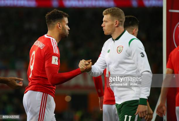 West Bromwich Albion team mates Hal RobsonKanu of Wales and James McClean of Republic of Ireland shake hands before the FIFA 2018 World Cup Qualifier...