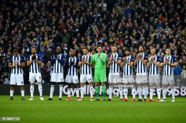West Bromwich Albion team take part in a minute applause in tribute to Cyrille Regis ahead of the Premier League match between West Bromwich Albion...