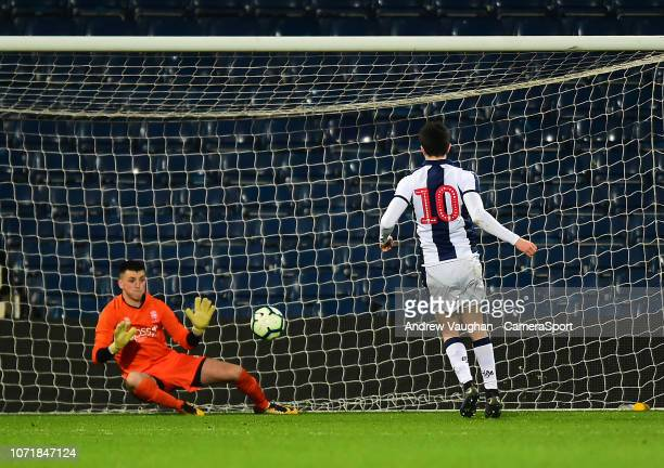 West Bromwich Albion U18's Fin Azaz scores his side's fourth goal from the penalty spot, sending Lincoln City U18's Matty White the wrong way during...