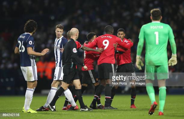 West Bromwich Albion's Ahmed Hegazi and Manchester United's Marcus Rashford clash after a challenge during the Premier League match at The Hawthorns...