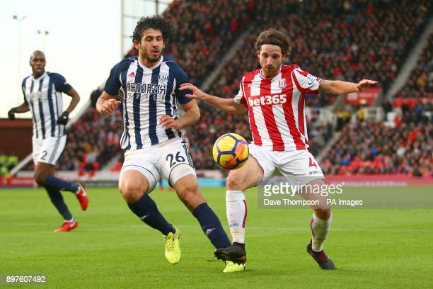 West Bromwich Albion's Ahmed Hegazy and Stoke City's Joe Allen battle for the ball during the Premier League match at the Bet365 Stadium Stoke