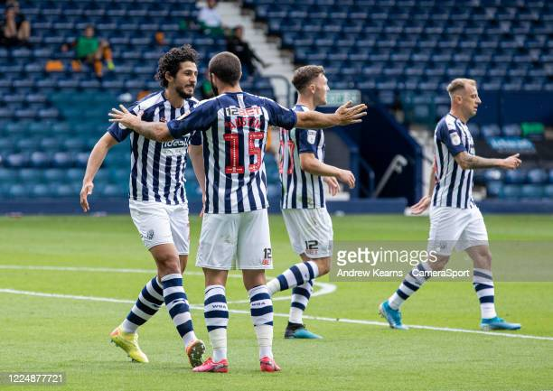 West Bromwich Albion's Ahmed Hegazy celebrates scoring his side's second goal with his team mate Charlie Austin competing with Hull City's during the...